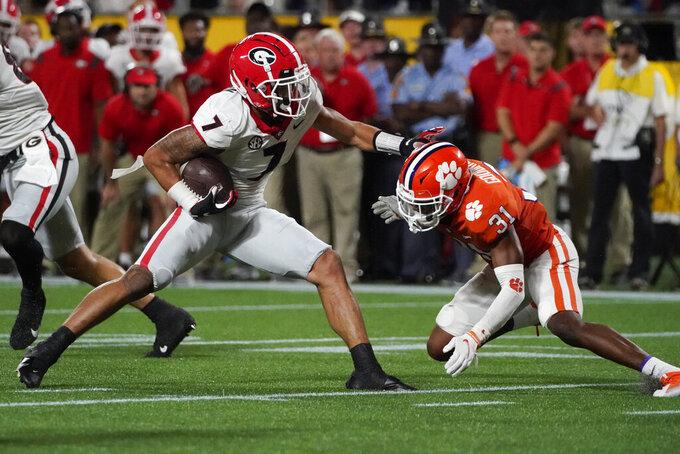 Georgia wide receiver Jermaine Burton runs past Clemson cornerback Mario Goodrich during the second half of an NCAA college football game Saturday, Sept. 4, 2021, in Charlotte, N.C. (AP Photo/Chris Carlson)
