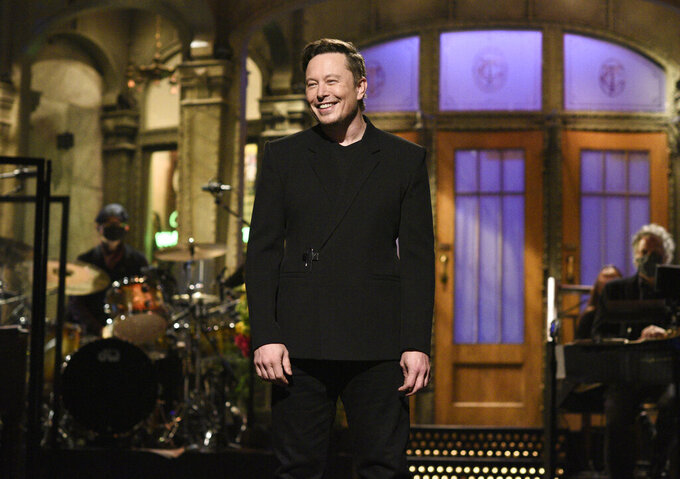 """This image released by NBC shows host Elon Musk delivering his opening monologue on """"Saturday Night Live"""" in New York on May 8, 2021. (Will Heath/NBC via AP)"""