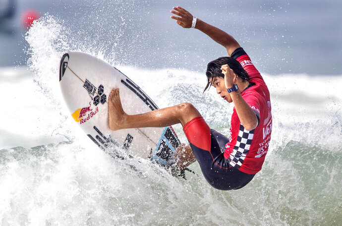 File-This Aug. 4, 2017, file photo shows Kanoa Igarashi, of Huntington Beach, Calif., surfing in his heat at the U.S. Open of Surfing in Huntington Beach, Calif. His father grew up surfing in Japan before moving to Huntington Beach, to be in the heart of surf country. The 22-year-old Igarashi has dual citizenship and elected to compete for Japan where's already a household name and been featured in a reality TV show. (Mark Rightmire/The Orange County Register via AP)