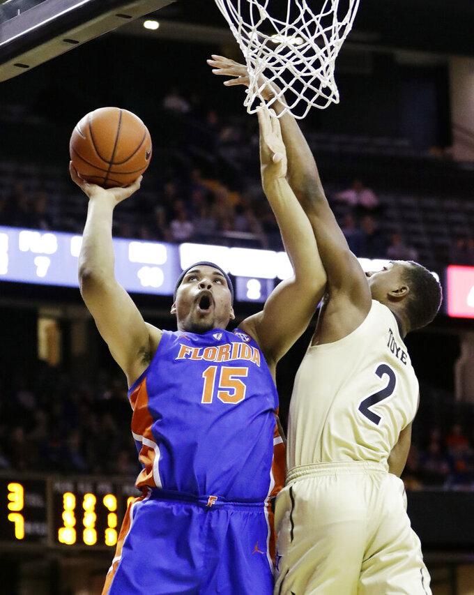 Florida forward Isaiah Stokes (15) shoots against Vanderbilt guard Joe Toye in the first half of an NCAA college basketball game Wednesday, Feb. 27, 2019, in Nashville, Tenn. (AP Photo/Mark Humphrey)