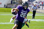 Northwestern running back Evan Hull (26) scores a touchdown past Ohio cornerback John Gregory during the first half of an NCAA college football game in Evanston, Ill., Saturday, Sept. 25, 2021. (AP Photo/Nam Y. Huh)
