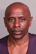 This booking photo released by the Dunn County Sheriff's Office on Thursday, Sept. 16, 2021 shows Darren Lee McWright, 56, in Menomonie, Wis. Sheriff's officials say one suspect has been arrested and a second suspect is being sought in connection with the fatal shootings of four people found in an abandoned SUV in western Wisconsin. Dunn County Sheriff Kevin Byrd says McWright, of St. Paul, Minnesota, who also uses the alias last name of Osborne, is being held in the Ramsey County Jail. Officials say a warrant is out for the other suspect, 38-year-old Antoine Darnique Suggs, who is believed to be in the Twin Cities area and is considered armed and dangerous. (Dunn County Sheriff's Office via AP)