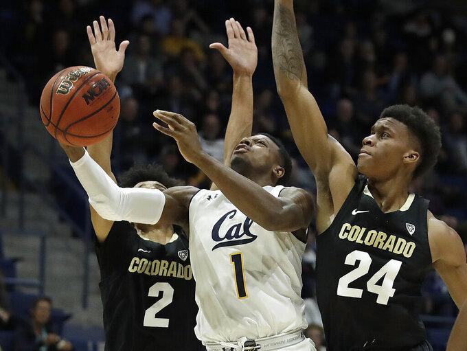 California's Darius McNeill, center, shoots between Colorado's Eli Parquet (24) and Daylen Kountz (2) during the first half of an NCAA college basketball game Thursday, Jan. 24, 2019, in Berkeley, Calif. (AP Photo/Ben Margot)