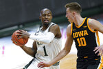 Michigan State guard Joshua Langford (1) drives on Iowa guard Joe Wieskamp (10) in the second half of an NCAA college basketball game in East Lansing, Mich., Saturday, Feb. 13, 2021. (AP Photo/Paul Sancya)