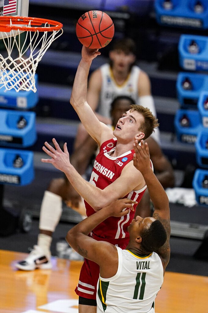 Wisconsin forward Tyler Wahl (5) shoots over Baylor guard Mark Vital (11) in the first half of a second-round game in the NCAA men's college basketball tournament at Hinkle Fieldhouse in Indianapolis, Sunday, March 21, 2021. (AP Photo/Michael Conroy)