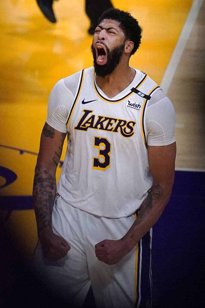Los Angeles Lakers forward Anthony Davis (3) celebrates after scoring during the second half of the team's NBA basketball game against the Phoenix Suns on Sunday, May 9, 2021, in Los Angeles. (AP Photo/Marcio Jose Sanchez)