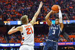 Duke guard Tre Jones (3) is defended by Syracuse forward Marek Dolezaj (21) during the first half of an NCAA college basketball game in Syracuse, N.Y., Saturday, Feb. 1, 2020. (AP Photo/Adrian Kraus)