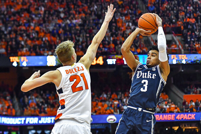 Duke guard Tre Jones (3) is defended by Syracuse forward Marek Dolezaj (21) during the first half of an NCAA college basketball game in Syracuse, N.Y., Saturday, Feb. 1, 2020. (AP Photo/Adrian Kraus)