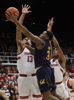 California guard Paris Austin (3) shoots against Stanford forward Oscar Da Silva (13) and KZ Okpala during the first half of an NCAA college basketball game in Stanford, Calif., Thursday, March 7, 2019. (AP Photo/Jeff Chiu)
