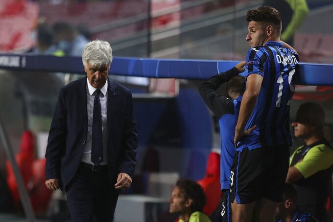 Atalanta's head coach Gian Piero Gasperini, left, reacts during the Champions League quarter-final soccer match between Atalanta and Paris Saint-Germain, at the Luz stadium in Lisbon, Portugal, Wednesday, Aug. 12, 2020. PSG won 2-1. (Rafael Marchante/Pool via AP)