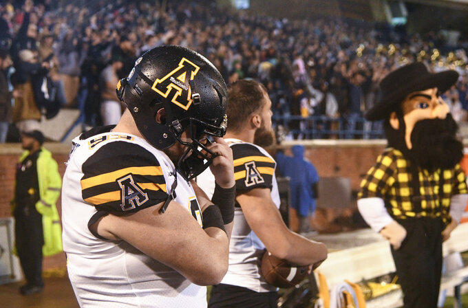 Appalachian State defensive lineman Josh Houser reacts after his team could not convert on third down during the fourth quarter of an NCAA college football game against Georgia Southern, Thursday, Oct. 25, 2018, in Statesboro, Ga. (AP Photo/John Amis)