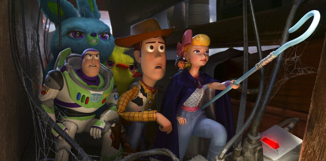 This image released by Disney shows, foreground from left, Buzz Lightyear, voiced by Tim Allen, Woody, voiced by Tom Hanks and Bo Peep, voiced by Annie Potts in a scene from the Oscar-nominated animated film
