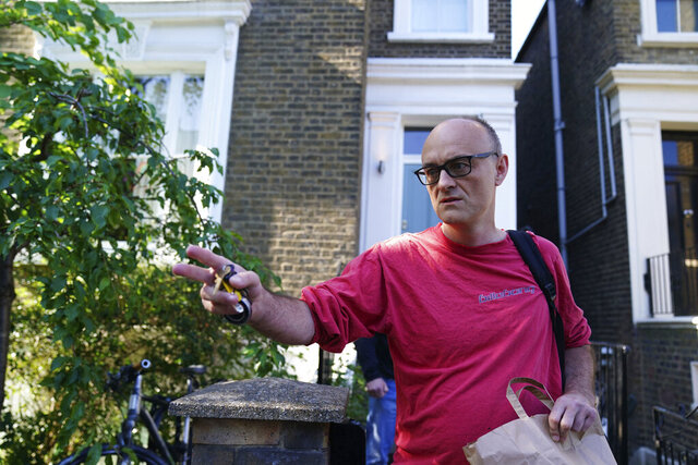 Prime Minister Boris Johnson's senior aide Dominic Cummings leaves his north London home, Monday May 25, 2020. British Prime Minister Boris Johnson is standing by his top aide, Cummings, who is accused of breaking lockdown rules by traveling 250 miles (400 km) to his parents' house while coming down with COVID-19. (Aaron Chown/PA via AP)