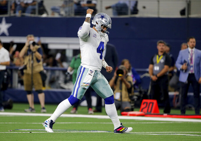 Dallas Cowboys' Dak Prescott (4) celebrates a touchdown against the Philadelphia Eagles in the first half of an NFL football game in Arlington, Texas, Sunday, Oct. 20, 2019. (AP Photo/Michael Ainsworth)