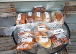 In this August 3, 2020 photo provided by Rick Everett, freshly baked loaves of bread and pastries sit outside Everett's home in Sydney, Australia, for friends and neighbors during the coronavirus pandemic. (Rick Everett via AP)