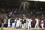 The San Diego Padres celebrate at home plate after Victor Caratini hit a home run against the Cincinnati Reds in the ninth inning of a baseball game Thursday, June 17, 2021, in San Diego. (AP Photo/Derrick Tuskan)