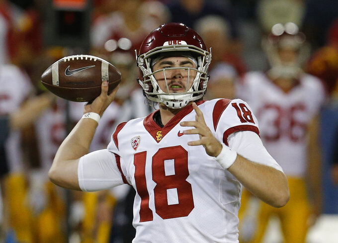 FILE - In this Saturday, Sept. 29, 2018, file photo, Southern California quarterback JT Daniels throws for a first down against Arizona in the first half during an NCAA college football game in Tucson, Ariz. USC hosts Colorado on Saturday, with the winner getting an inside track on the Pac-12 South title. (AP Photo/Rick Scuteri, File)