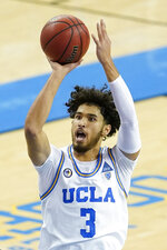 UCLA guard Johnny Juzang shoots during the second half of the team's NCAA college basketball game against San Diego on Wednesday, Dec. 9, 2020, in Los Angeles. (AP Photo/Ashley Landis)