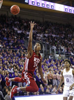 Washington State's Noah Williams (24) shoots against Washington during the first half of an NCAA college basketball game Friday, Feb. 28, 2020, in Seattle. (AP Photo/Elaine Thompson)