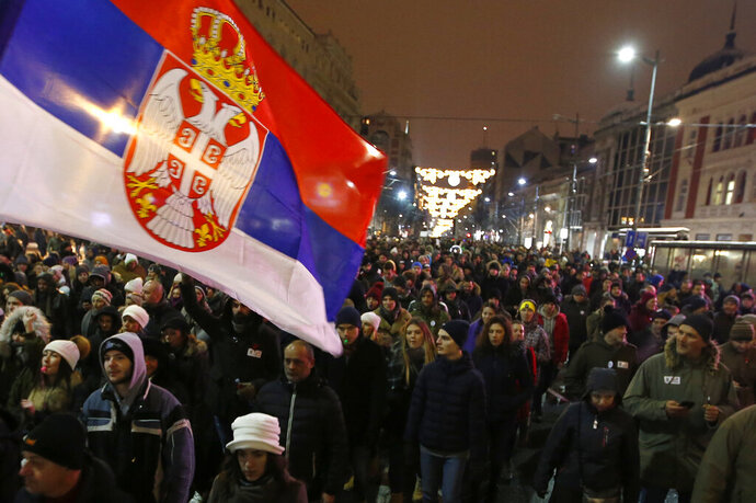 People march during a protest against populist President Aleksandar Vucic in Belgrade, Serbia, Saturday, Jan. 12, 2019. Critics accuse the president of imposing an autocracy through strict control over the media and promoting hate speech against the opponents. (AP Photo/Darko Vojinovic)