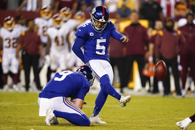 New York Giants kicker Graham Gano (5) kicks a field goal during the second half of an NFL football game against the Washington Football Team, Thursday, Sept. 16, 2021, in Landover, Md. (AP Photo/Alex Brandon)