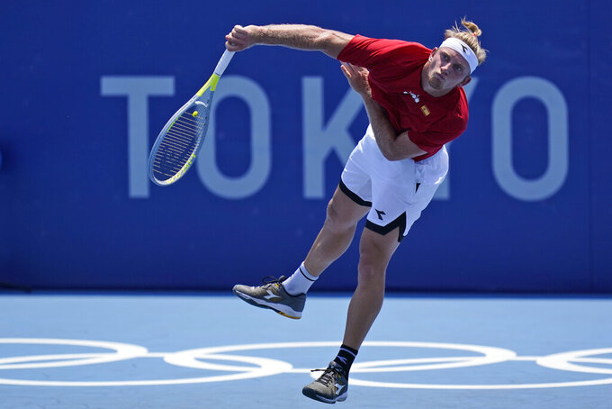 Alejandro Davidovich Fokina, of Spain, serves to Pedro Sousa, of Portugal, during the first round of the tennis competion at the 2020 Summer Olympics, Saturday, July 24, 2021, in Tokyo, Japan. (AP Photo/Seth Wenig)