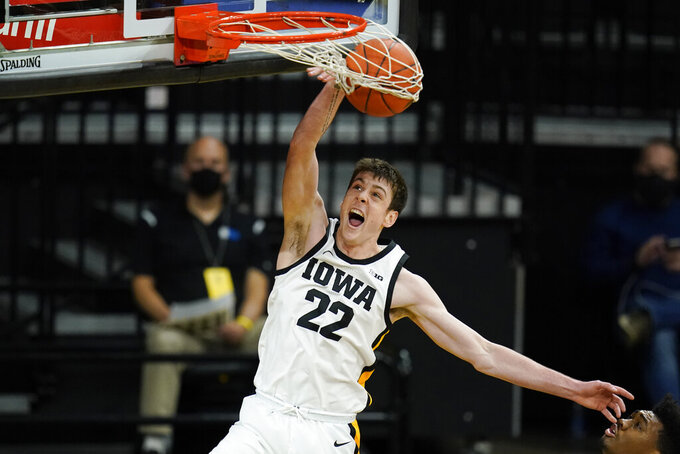 Iowa forward Patrick McCaffery dunks the ball during the second half of an NCAA college basketball game against Northern Illinois, Sunday, Dec. 13, 2020, in Iowa City, Iowa. Iowa won 106-54. (AP Photo/Charlie Neibergall)