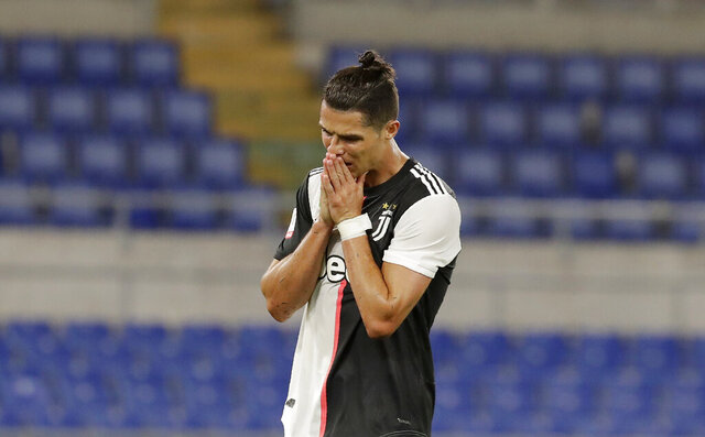 Juventus' Cristiano Ronaldo reacts after missing a scoring chance during the Italian Cup soccer final match between Napoli and Juventus, at Rome's Olympic Stadium, Wednesday, June 17, 2020. (AP Photo/Andrew Medichini)