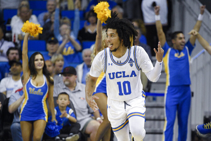 UCLA guard Tyger Campbell celebrates after making a three-point basket during the second half of an NCAA college basketball game against Utah in Los Angeles, Sunday, Feb. 2, 2020. (AP Photo/Kelvin Kuo)