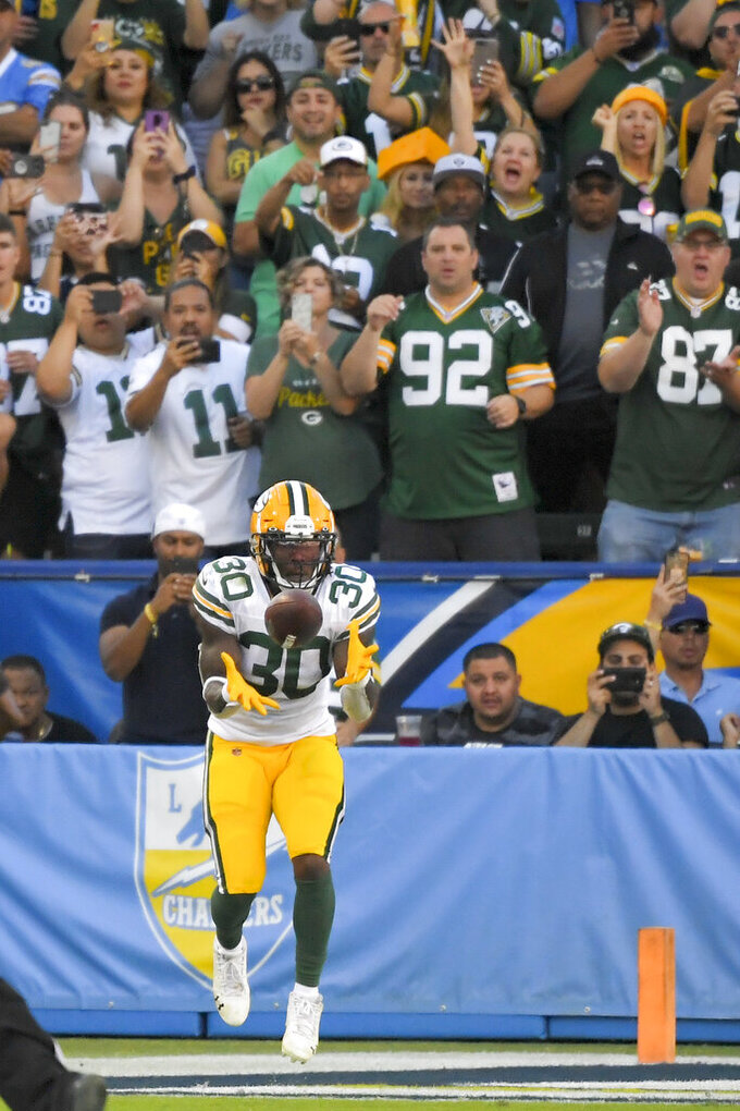 Green Bay Packers running back Jamaal Williams scores against the Los Angeles Chargers during the second half of an NFL football game Sunday, Nov. 3, 2019, in Carson, Calif. (AP Photo/Mark J. Terrill)
