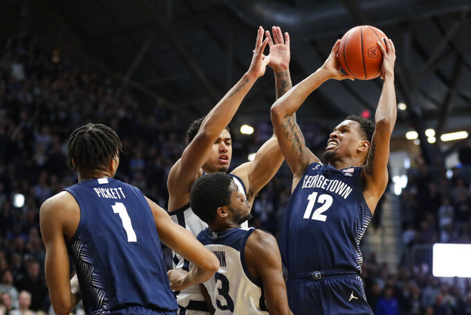 Georgetown guard Terrell Allen (12) shoots over Butler guard Kamar Baldwin (3) in the second half of an NCAA college basketball game in Indianapolis, Saturday, Feb. 15, 2020. Georgetown defeated Butler 73-66. (AP Photo/Michael Conroy)