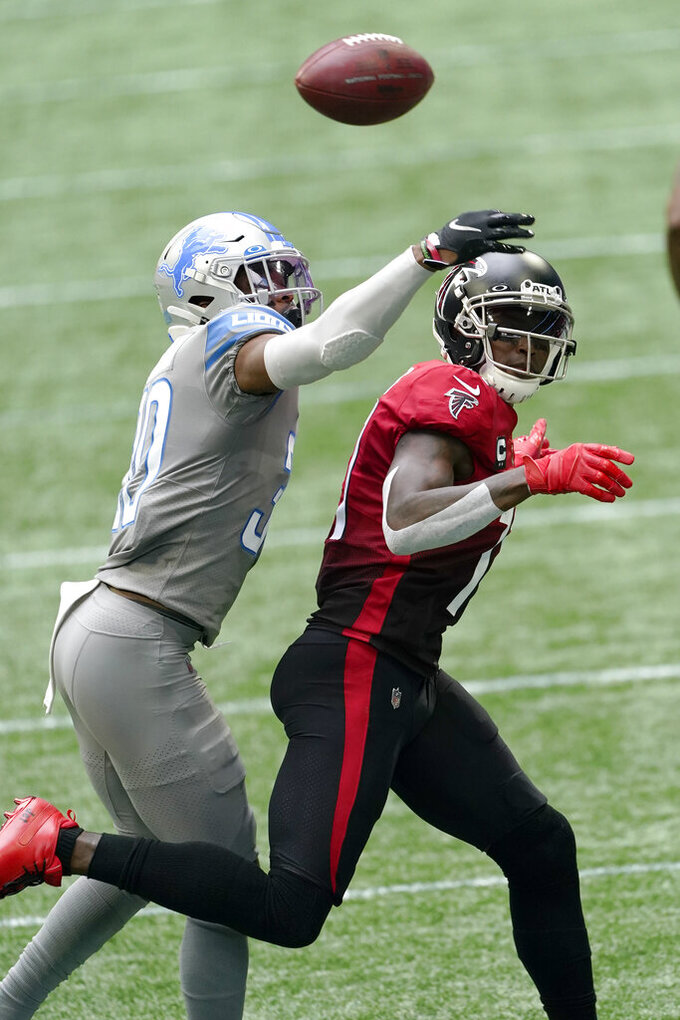 Detroit Lions cornerback Jeff Okudah (30) breaks up a pass intended for Atlanta Falcons wide receiver Julio Jones (11) during the first half of an NFL football game, Sunday, Oct. 25, 2020, in Atlanta. (AP Photo/John Bazemore)
