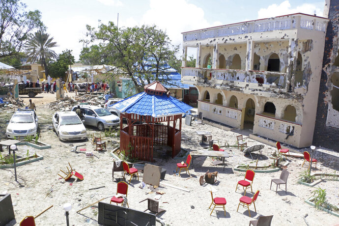 A view of Asasey Hotel after an attack, in Kismayo , Somalia, Saturday July 13, 2019.  At least 10 people, including two journalists, were killed in an extremist attack Friday on a hotel in the port city of Kismayo, a Somali official said. The attack started with a suicide car bomb blast and then gunmen stormed into the hotel. (AP Photo)