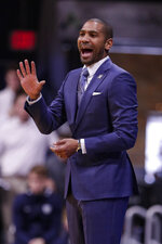 Butler head coach LaVail Jordan calls a play for his team as they played against Florida in the first half of an NCAA college basketball game in Indianapolis, Saturday, Dec. 7, 2019. (AP Photo/Michael Conroy)