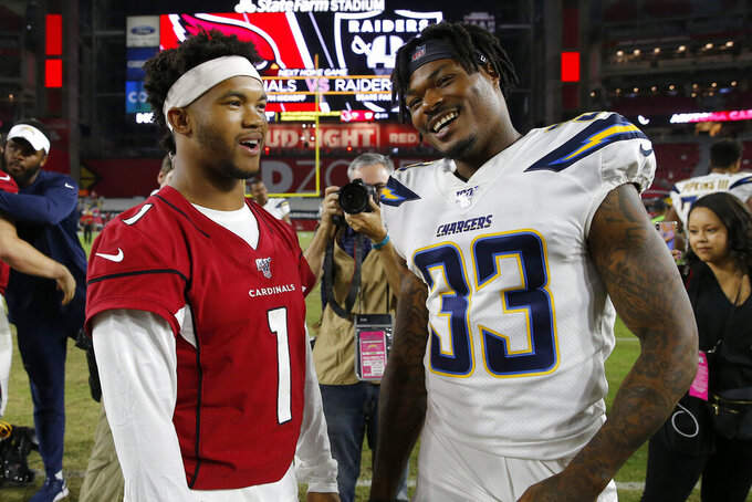 Arizona Cardinals quarterback Kyler Murray (1) greets Los Angeles Chargers free safety Derwin James (33) after an NFL preseason football game, Thursday, Aug. 8, 2019, in Glendale, Ariz. (AP Photo/Rick Scuteri)