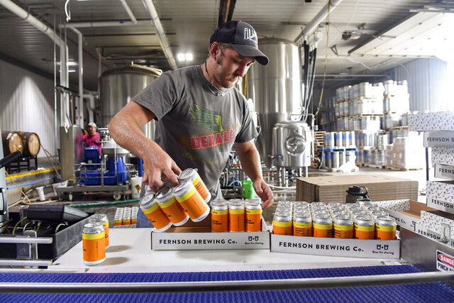 Jake Gunderson boxes six packs of Skip Day, a specialty brew, on Monday, Aug. 3, 2020 at Fernson Brewery in Sioux Falls, S.D. (Erin Bormett/Argus Leader via AP)