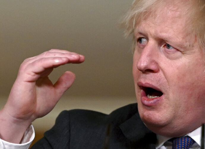 Britain's Prime Minister Boris Johnson speaks during a coronavirus press conference at 10 Downing Street in London, Friday Jan. 22, 2021.  Johnson announced that the new variant of COVID-19, which was first discovered in the south of England, may be linked with a possible increase in the mortality rate. (Leon Neal/Pool via AP)