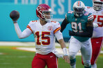 Kansas City Chiefs quarterback Patrick Mahomes (15) looks to pass the football during the first half of an NFL football game against the Miami Dolphins, Sunday, Dec. 13, 2020, in Miami Gardens, Fla. (AP Photo/Wilfredo Lee)