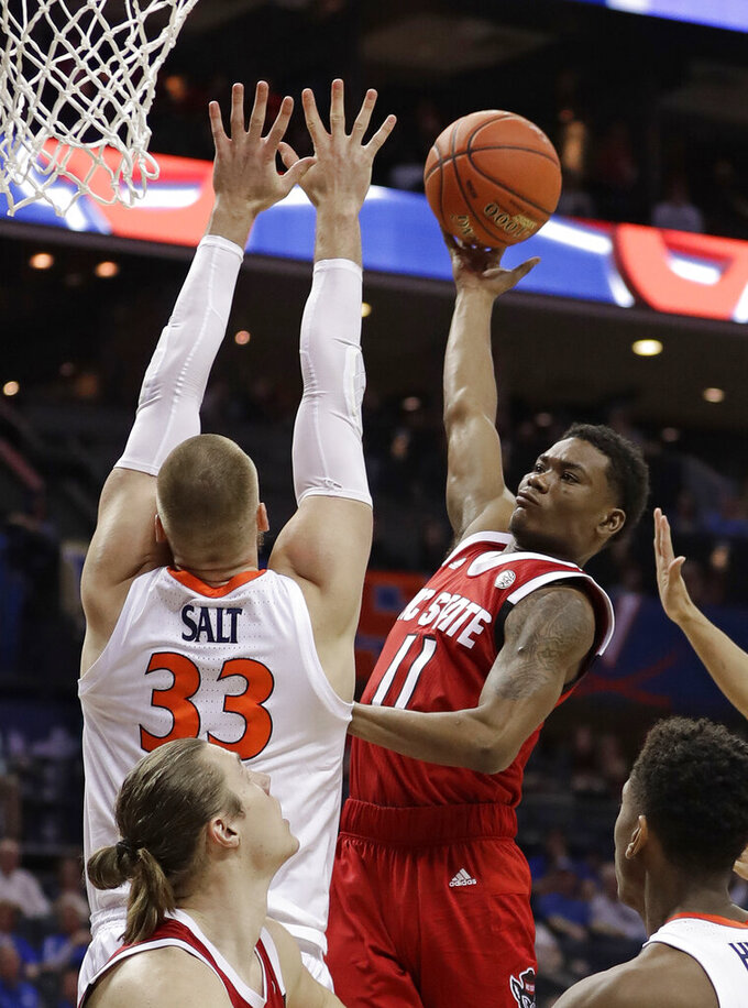 North Carolina State's Markell Johnson (11) shoots against Virginia's Jack Salt (33) during the first half of an NCAA college basketball game in the Atlantic Coast Conference tournament in Charlotte, N.C., Thursday, March 14, 2019. (AP Photo/Nell Redmond)