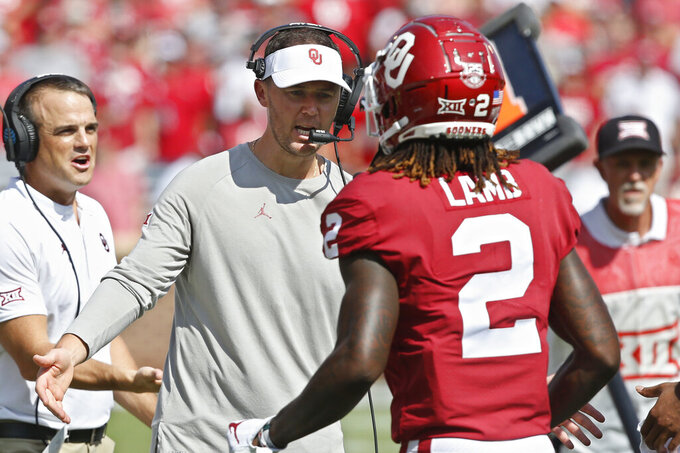 Oklahoma head coach Lincoln Riley greets wide receiver CeeDee Lamb (2) following a touchdown in the second quarter of an NCAA college football game against Texas Tech in Norman, Okla., Saturday, Sept. 28, 2019. (AP Photo/Sue Ogrocki)