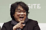 "Bong Joon-ho, director of Oscar-winning ""Parasite,"" gestures during a press conference in Seoul, South Korea, Wednesday, Feb. 19, 2020. Bong said Wednesday ""the biggest pleasure and the most significant meaning"" that the film has brought to him was its success in many countries though the audiences might feel uncomfortable with his explicit description of a bitter wealth disparity in modern society. (AP Photo/Ahn Young-joon)"