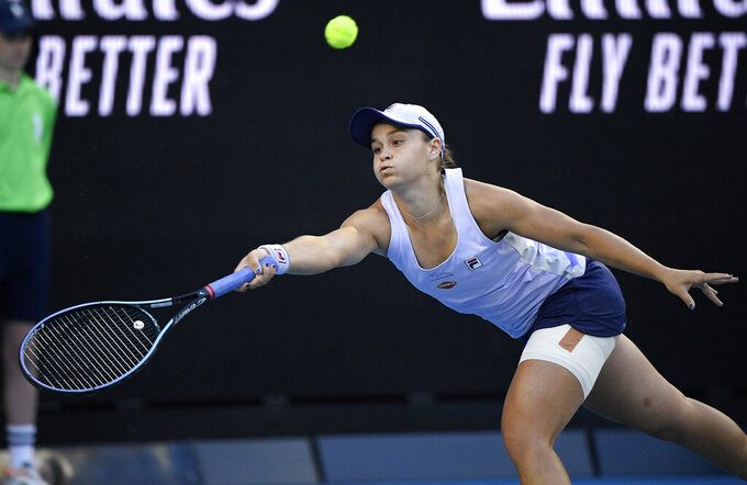 Australia's Ash Barty hits a forehand return to Russia's Ekaterina Alexandrova during their third round match at the Australian Open tennis championship in Melbourne, Australia, Saturday, Feb. 13, 2021.(AP Photo/Andy Brownbill)