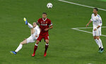 FILE - In this Saturday, May 26, 2018 file photo Real Madrid's Gareth Bale, left, scores his side's 2nd goal during the Champions League Final soccer match between Real Madrid and Liverpool at the Olimpiyskiy Stadium in Kiev, Ukraine. (AP Photo/Darko Vojinovic, File)