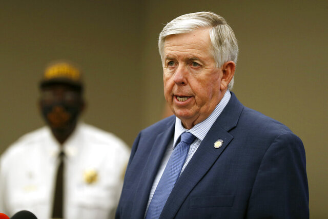 FILE - In this Aug. 6, 2020 file photo, Missouri Gov. Mike Parson speaks during a news conference in St. Louis. Gov. Parson, a Republican who has steadfastly refused to require residents to wear mask, and First Lady Teresa Parson tested positive for COVID-19, Wednesday, Sept. 23, 2020. (AP Photo/Jeff Roberson, File)
