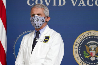 The Latest: Dr Fauci warns of possible virus surge in US