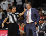 Illinois head coach Brad Underwood, right, disputes a call with an official during the first half of an NCAA college basketball game against Iowa, Sunday, Jan. 20, 2019, in Iowa City. (AP Photo/Matthew Putney)
