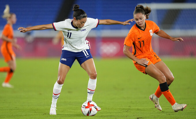 United States' Christen Press, left, and Netherlands' Lieke Martens battle for the ball during a women's quarterfinal soccer match at the 2020 Summer Olympics, Friday, July 30, 2021, in Yokohama, Japan. (AP Photo/Silvia Izquierdo)