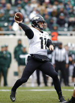 FILE - In this Oct. 27, 2018, file photo, Purdue quarterback David Blough throws a pass during an NCAA college football game against Michigan State, in East Lansing, Mich. Blough had been about the hottest thing going in the Big Ten before throwing three interceptions last week against Michigan State. It won't get any easier for Blough at home against Iowa. (AP Photo/Al Goldis, File)
