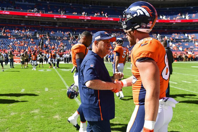Denver Broncos Head Coach Vic Fangio encourages Andrew Beck (83) during pregame warmups in the NFL game against the Jacksonville Jaguars in Denver Sunday, Sept. 29, 2019. (Eric Bakke via AP)