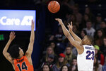 Gonzaga guard Zach Norvell Jr. (23) shoots while defended by Pacific guard Ajare Sanni (14) during the first half of an NCAA college basketball game in Spokane, Wash., Thursday, Jan. 10, 2019. (AP Photo/Young Kwak)